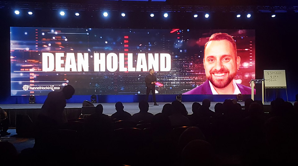 dean holland on stage at ClickFunnels conference image